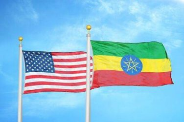 143075993-united-states-and-ethiopia-two-flags-on-flagpoles-and-blue-cloudy-sky-background